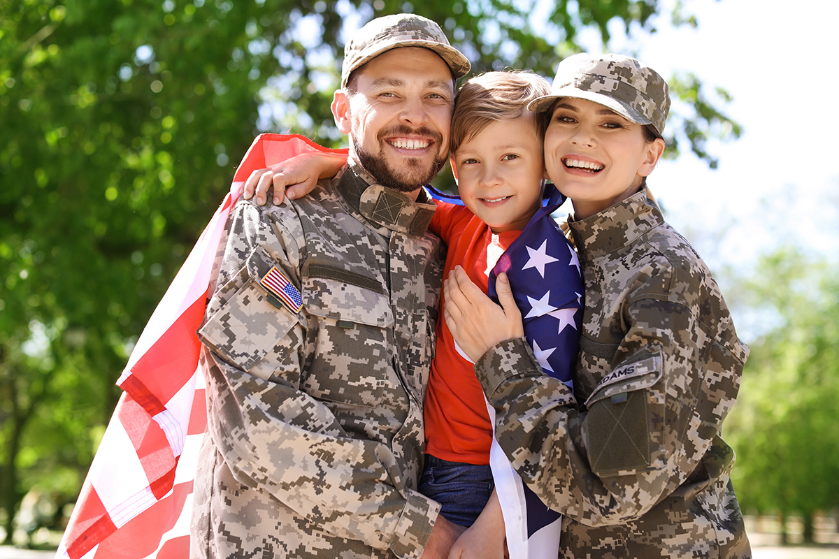 Happy military family with their son outdoors